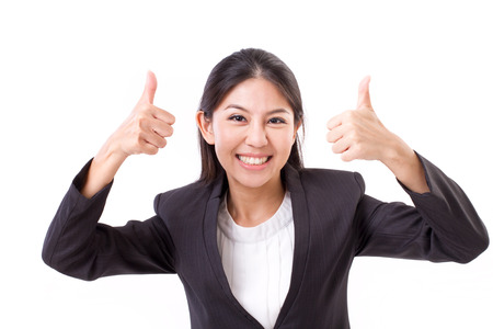Happy, smiling, successful business woman showing thumb up gesture
