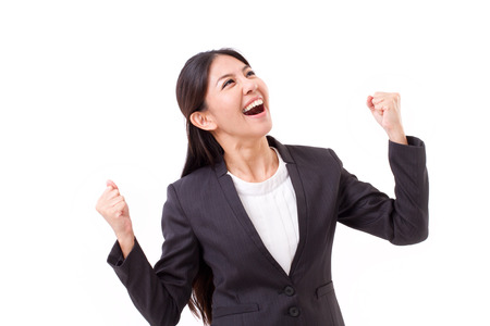 exited, successful business woman looking up Stock Photo
