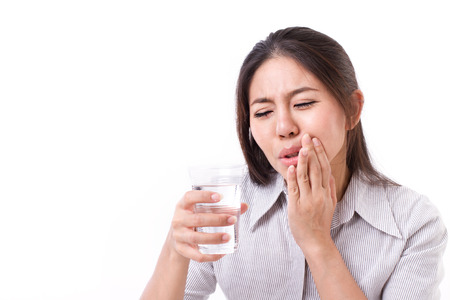 Woman suffering from tooth sensitivity Stock Photo - 43847824