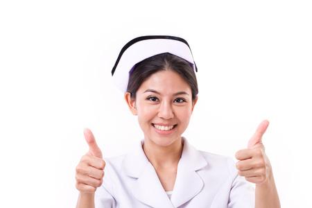 手のサインを 2 つの親指を与える笑顔の看護師 写真素材