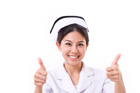 smiling nurse giving two thumbs up hand sign Archivio Fotografico