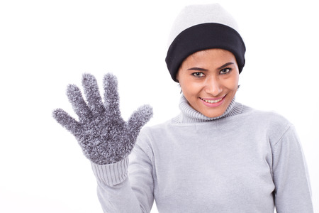 winning mood: happy woman pointing up five fingers Stock Photo