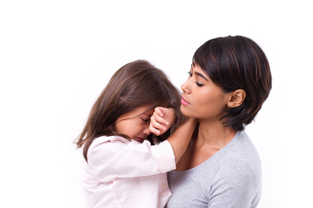 beautiful crying woman: mother comforting crying daughter, family problem solution