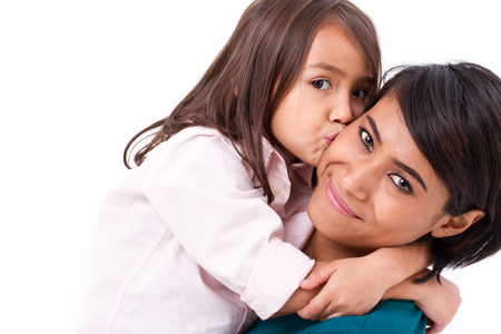 race relations: adorable little girl kissing her mothers cheek