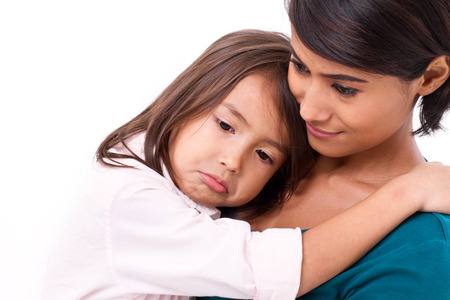 mother comforting, caring her daughter in unhappy, sad, negative emotion