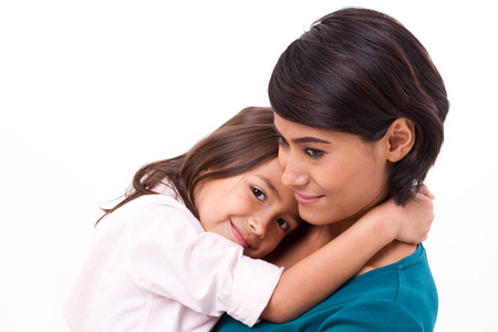kid friendly: little daughter hugging her mother, concept of happy family or love Stock Photo