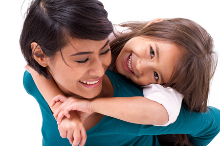two girls hugging: little daughter hugging her mother, concept of happy family or love Stock Photo
