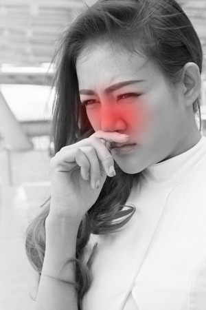 running nose: sick woman with running nose, cold, influenza
