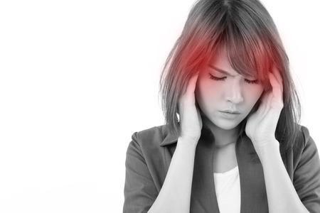 thirties: stressful business woman suffers from headache, stress, overwork, migraine on white isolated background Stock Photo