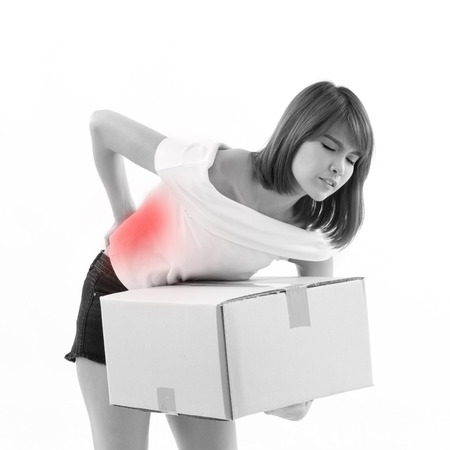 carrying heavy: unhappy woman carrying heavy box with pain