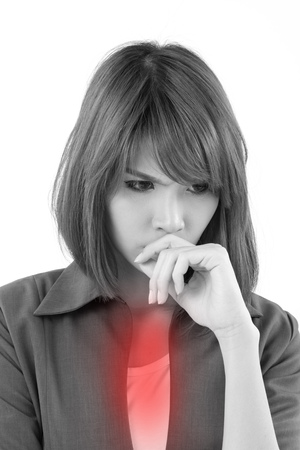 acid reflux: business woman suffering from nausea or acid reflux