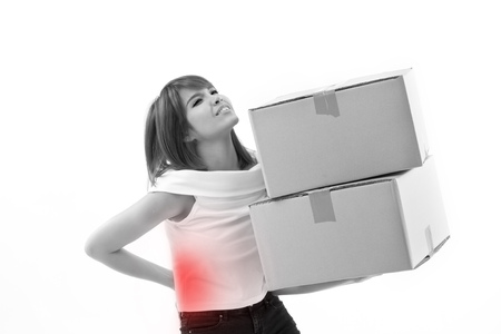 backpain: unhappy woman carrying heavy boxes with back pain