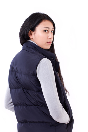 sideway: confident asian-caucasian woman looking back