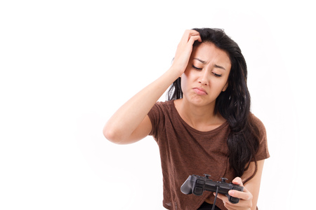 stressed, exited female gamer isolated