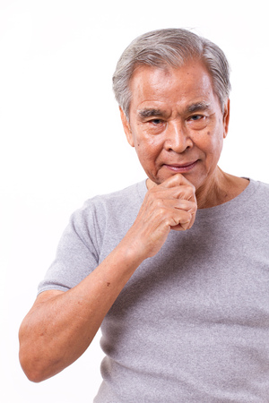 anxious face: confident senoir man thinking