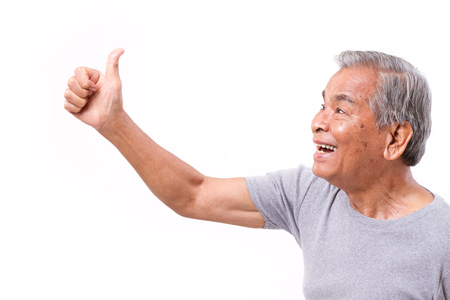 old asian: happy senior man giving thumb up gesture