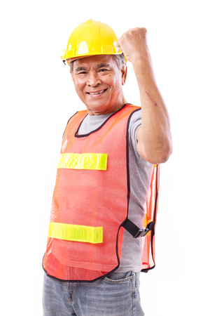 happy worker: successful and tough senior construction worker or engineer with scar