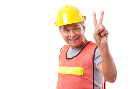 happy, smiling construction worker showing 2 fingers gesture, victory sign