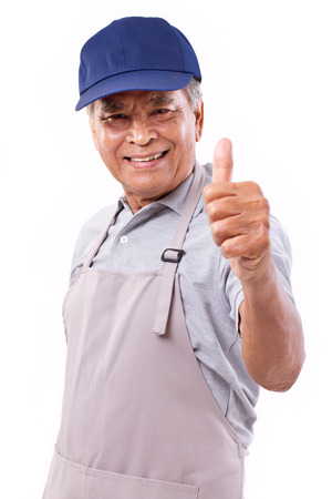 happy worker: smiling happy worker giving thumb up hand gesture