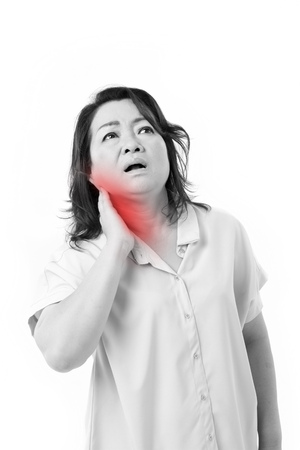 shoulder problem: middle aged woman suffering from neck pain Stock Photo