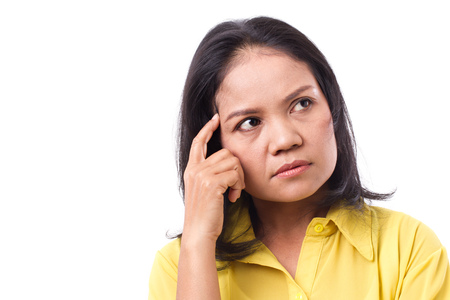 age: stressed woman thinking, looking up Stock Photo