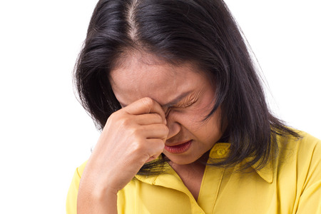 frustration: frustrated woman suffering from headache or stress