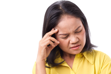 suffering: frustrated woman suffering from headache or stress