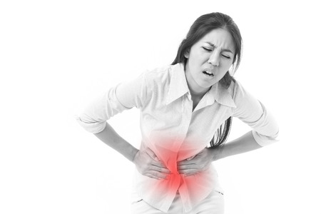 pain: woman suffering from stomach pain, menstruation cramp Stock Photo