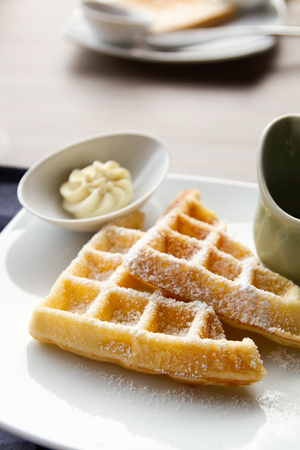 butter icing: waffle with icing sugar, butter, syrup Stock Photo