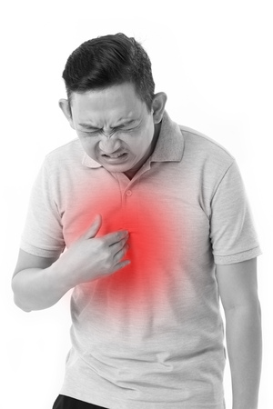 constipation symptom: man suffering from acid reflux