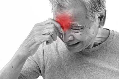 man face: senior man suffering from headache, stress, migraine