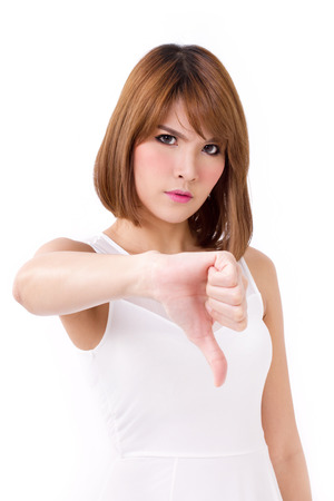 frustrated, upset, displeased woman giving thumb down gesture Stock Photo