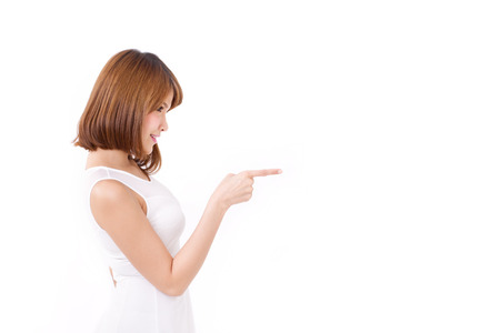 pointing finger up: woman pointing up to blank space Stock Photo