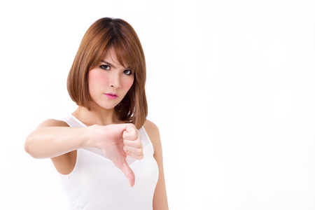displeased: frustrated, upset, displeased woman giving thumb down gesture Stock Photo