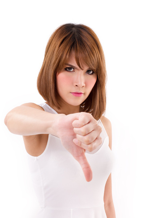 stares: angry, frustrated woman giving thumb down Stock Photo