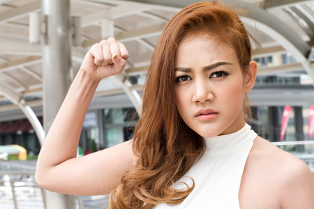 camera girl: angry woman preparing to punch Stock Photo