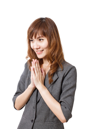 equivalent: welcoming business womans greeting gesture in exotic asian style, equivalent to western handshake Stock Photo