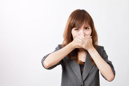 covering: business woman firmly covering her mouth Stock Photo