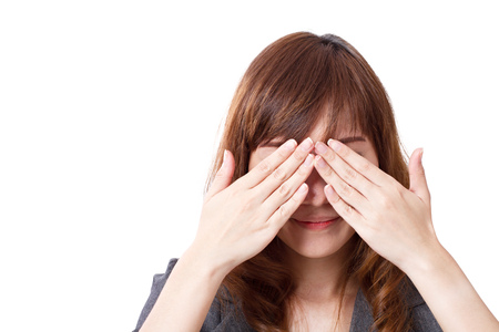 covering: business woman covering her eyes Stock Photo