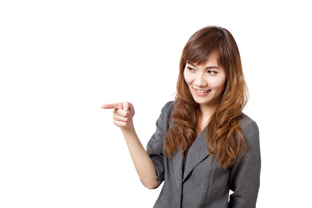 sideways: business woman pointing sideways Stock Photo
