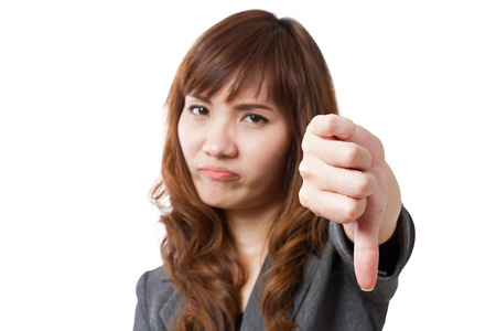 thumb down: thumb down hand gesture of business woman Stock Photo