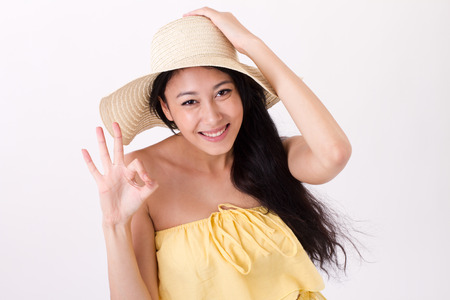 summer sign: young summer woman giving ok hand sign