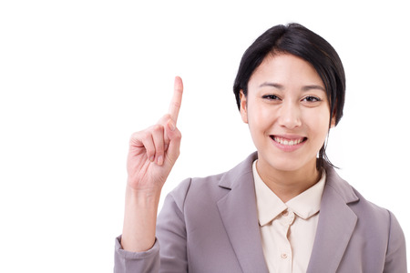 one finger: businesswoman pointing up one finger gesture Stock Photo