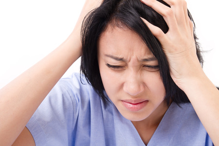 aching: patient suffering from headache, stress