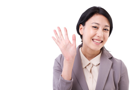 asian women: happy asian caucasian business woman waiving her hand Stock Photo
