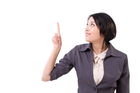 woman pointing up: business woman pointing up to the space