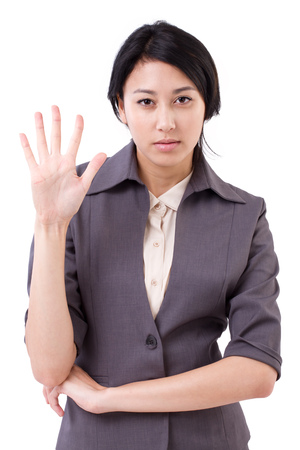 five fingers: confident businesswoman pointing up 5 fingers gesture