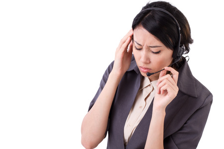 suffers: frustrated, upset business woman suffers from headache