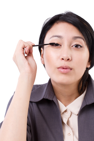 making up: happy business womans grooming, making up, looking at camera Stock Photo