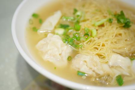 thai noodle soup: asian egg noodle soup with shrimp dumpling Stock Photo